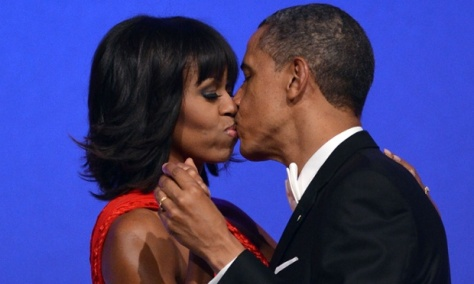First lady and President Barack Obama share a kiss during their first dance!