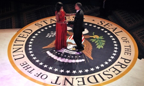 President Barack Obama and first lady Michelle Obama begin to dance together at the Commander-in-Chief's Inaugural Ball.
